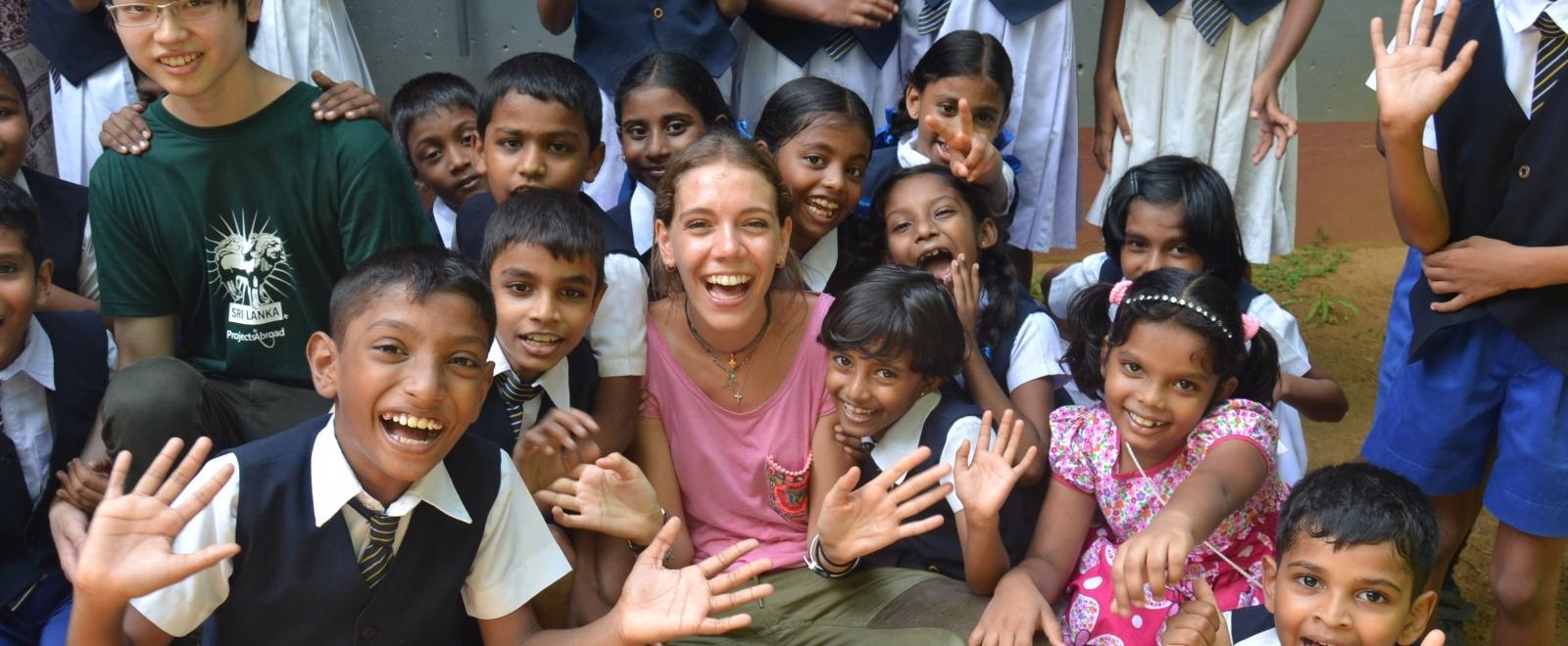 Two High School Special volunteers overseas for Christmas enjoy spending time teaching children in Sri Lanka.